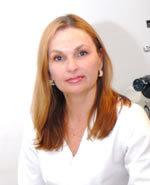 Белые сгустки в выделениях у женщин: причины, как выявить болезнь
